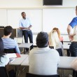 Male Tutor Teaching University Students In Classroom — Stock Photo #48459307