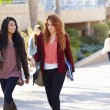 Female Students Walking Outdoors On University Campus — Stock Photo