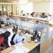 Interior Of Busy Modern Open Plan Office — Stock Photo #48459455