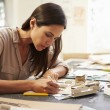 Female Architect Making Model In Office — Stock Photo #48459559