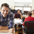 Portrait Of Male Architect With Meeting In Background — Stock Photo #48459567