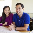 Architects Studying Plans In Modern Office Together — Stock Photo #48459577