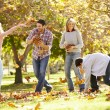 Rear View Of Family Walking Through Autumn Woodland — Stock Photo #48459697