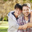 Portrait Of Father And Son In Countryside — Stock Photo #48459767