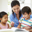 Mother Helping Children With Homework — Stock Photo #48459831