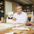 Group Of Architects Sitting Around Table Having Meeting — Stock Photo #48459841