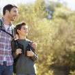 Father And Son Hiking In Countryside Wearing Backpacks — Stock Photo #48459857