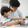 Father Helping Son To Use Laptop — Stock Photo
