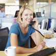 Woman On Phone In Busy Modern Office — Stock Photo #48459957