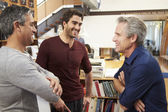 Three Male Architects Chatting In Modern Office Together — Stock Photo