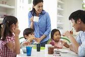 Three Asian Children Having Breakfast — Stock Photo