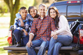 Family Sitting In Pick Up Truck On Camping Holiday — Stock Photo
