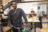 Architect Arrives At Work On Bike Pushing It Through Office — Stock Photo