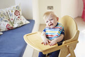 Boy Sitting In High Chair — Stock Photo