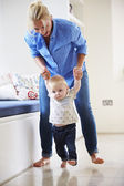 Mother Helping Young Son Walk — Stock Photo