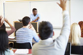 Male Tutor Teaching University Students In Classroom — Foto Stock