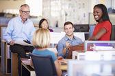 Businesspeople Having Meeting In Modern Open Plan Office — Stock Photo