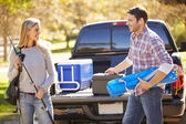 Couple Unpacking Pick Up Truck On Camping Holiday — Stock Photo