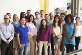 Portrait Of Multi-Cultural Office Staff Standing In Lobby — Stock Photo