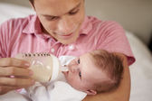 Father Giving Daughter Bottle Of Milk — Stok fotoğraf