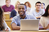 Male University Student Using Laptop In Lecture — Stock Photo