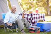 Senior Man On Camping Holiday — Stockfoto