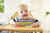 Baby Boy Eating Fruit — Stockfoto