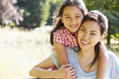 Asian Mother And Daughter In Countryside — Stock Photo