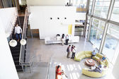 Reception Area Of Modern Office Building With People — Stok fotoğraf