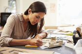 Female Architect Making Model In Office — Stock Photo