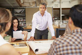 Male Boss Leading Meeting Of Architects Sitting At Table — Stock Photo