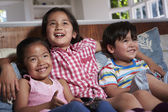 Three Asian Children Watching TV Together — Stok fotoğraf