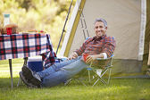 Man Enjoying Camping Holiday In Countryside — Stock Photo