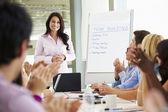 Businesswoman Addressing Meeting — Stock Photo