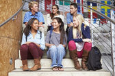 High School Students Sitting Outside Building — Stock Photo
