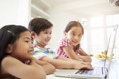 Three Asian Children Using Laptop — Stok fotoğraf