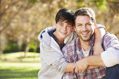 Portrait Of Father And Son In Countryside — Stock Photo