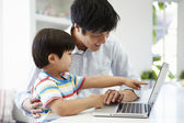 Father Helping Son To Use Laptop — Stockfoto