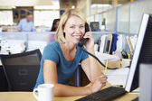 Woman On Phone In Busy Modern Office — Stock Photo