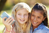 Two Girls Taking Selfie With Mobile Phone — Stockfoto