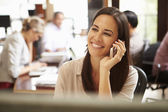 Businesswoman Working At Desk Using Mobile Phone — Stock Photo