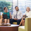 Group Of Businesspeople Having Meeting In Office Lobby — Stock Photo #48460479