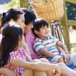 Asian Family Resting By Fence — Stock Photo #48460755