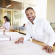 Male Architect Studying Plans In Office — Stock Photo #48460307