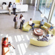 Reception Area Of Modern Office Building With People — Stock Photo #48460461