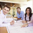 Group Of Architects Discussing Plans In Modern Office — Stock Photo #48460511