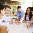Group Of Architects Discussing Plans In Modern Office — Stock Photo #48460619