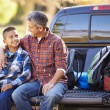 Father And Son Sitting In Pick Up Truck On Camping Holiday — Stock Photo #48460621