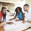 Group Of Architects Discussing Plans In Modern Office — Stock Photo #48460689