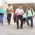 High School Pupils And Teacher On Steps — Stock Photo #48460835